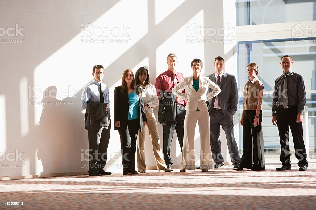 Group of businesspeople standing at large window  stock photo
