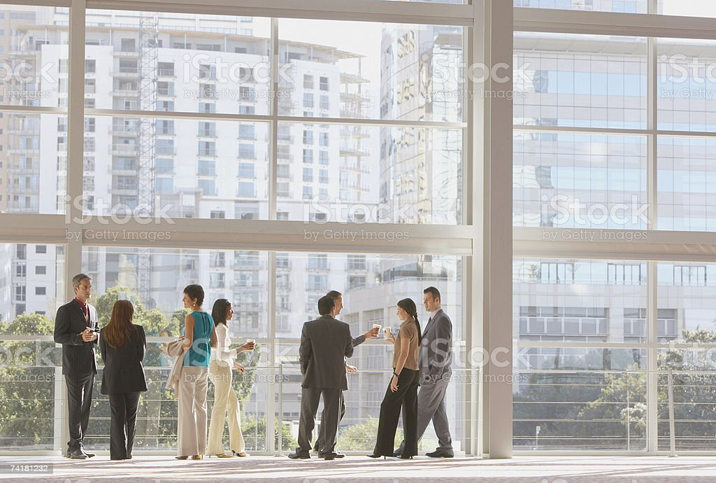 Group of businesspeople with large window royalty-free stock photo