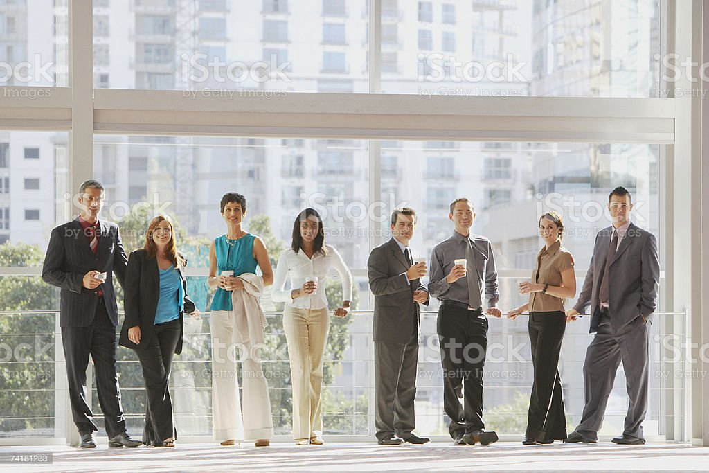 Group of businesspeople with large window stock photo