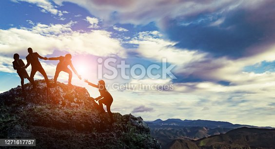 Group of businessperson climbing a mountain. Challenge of business concept.