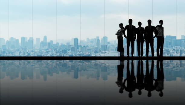 Group of businessperson in front of the city. stock photo
