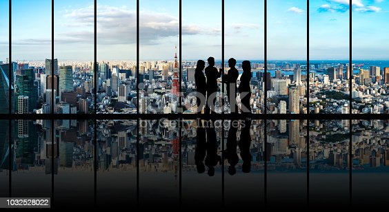 istock Group of businessperson in front of the urban cityscape. 1032528022