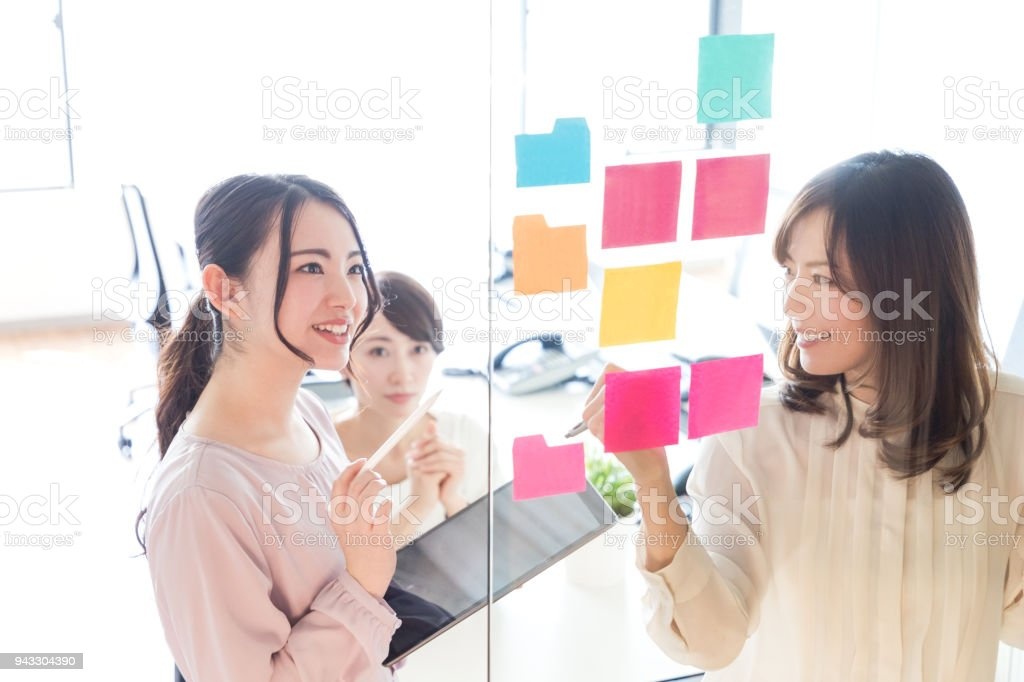 Group of businesswoman in meeting room. stock photo