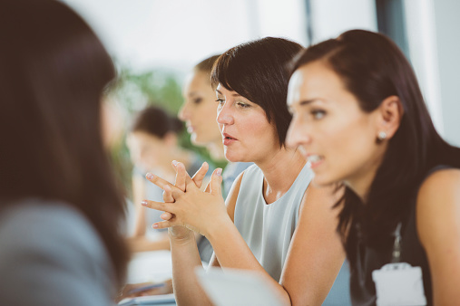 Group Of Businesswomen At Meeting Stock Photo - Download Image Now