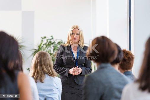 1028234706 istock photo Group of businesswomen during seminar 521457231