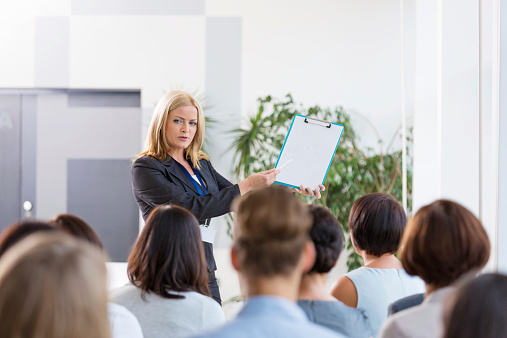 Group Of Businesswomen During Seminar Stock Photo - Download Image Now