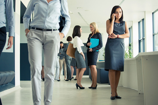 Group Of Businesswomen In An Office Corridor Stock Photo - Download Image Now