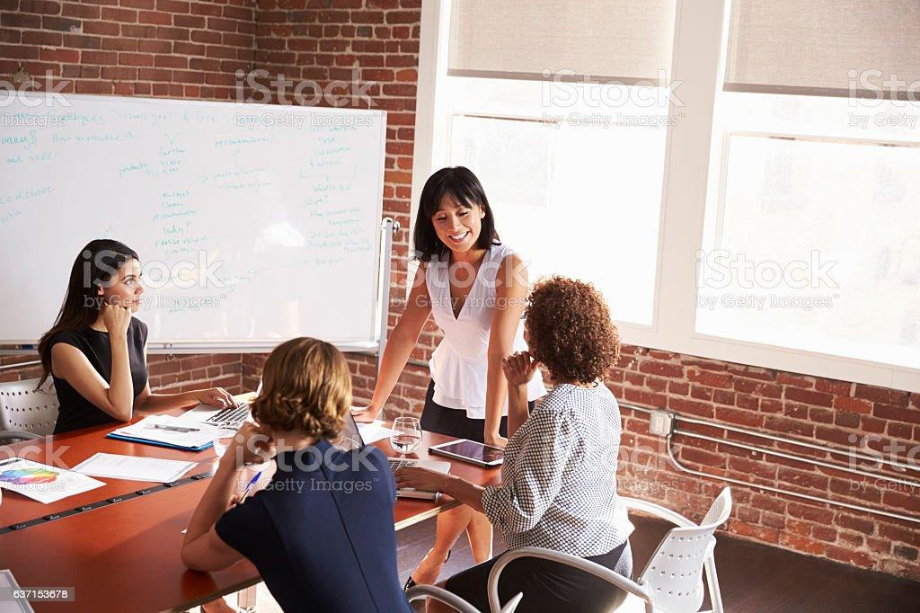 Group Of Businesswomen Meeting In Modern Boardroom stock photo
