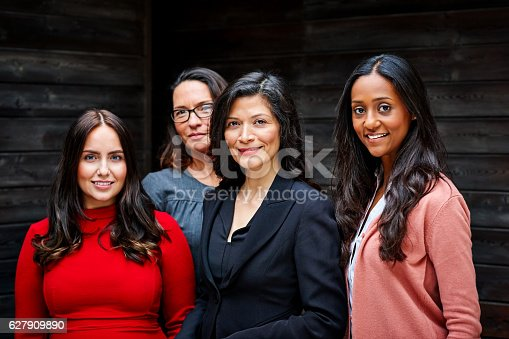 istock Group of businesswomen standing together in office 627909890