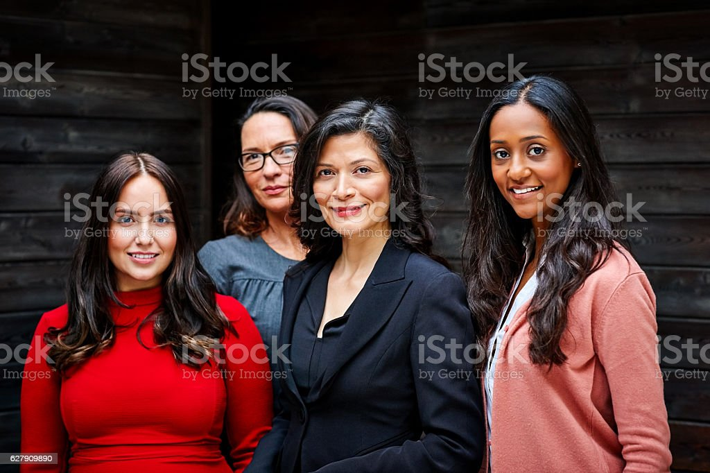 Group of businesswomen standing together in office stock photo