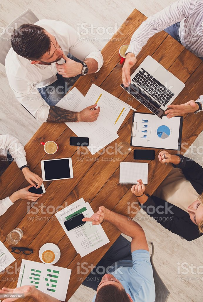 Group of busy business people working in office, top view of wooden...