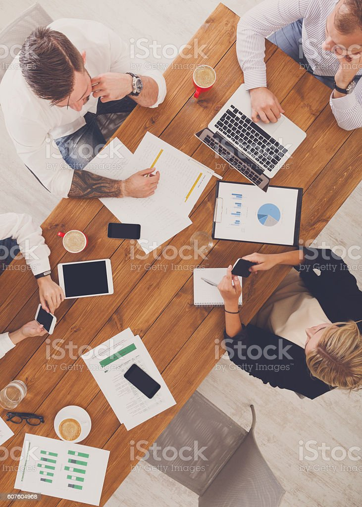 Group of busy business people working in office, top view stock photo