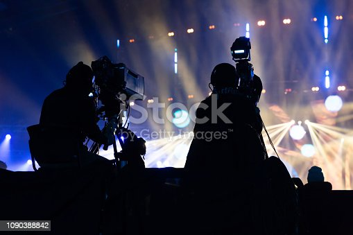 istock A group of cameramen working during the concert. 1090388842