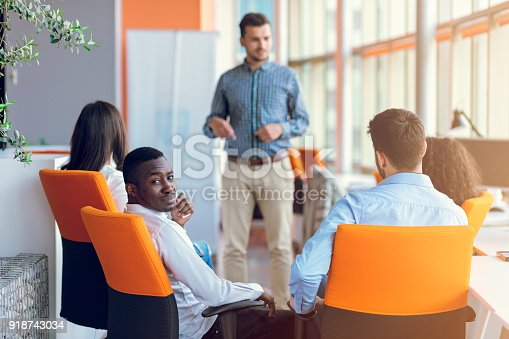 istock Group of casually dressed businesspeople discussing ideas in the office. 918743034