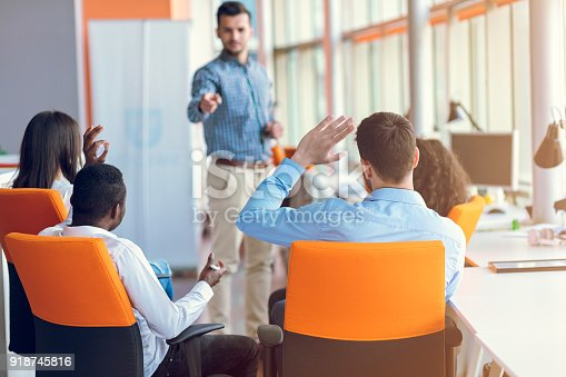 istock Group of casually dressed businesspeople discussing ideas in the office. 918745816