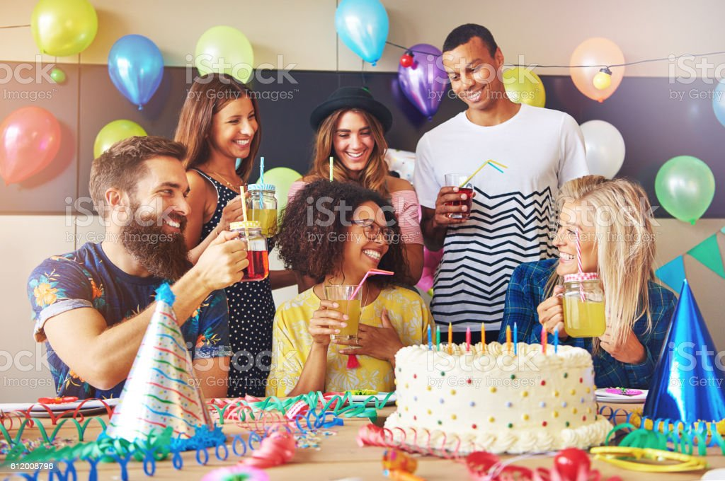 Group of Caucasian and African friends at party stock photo