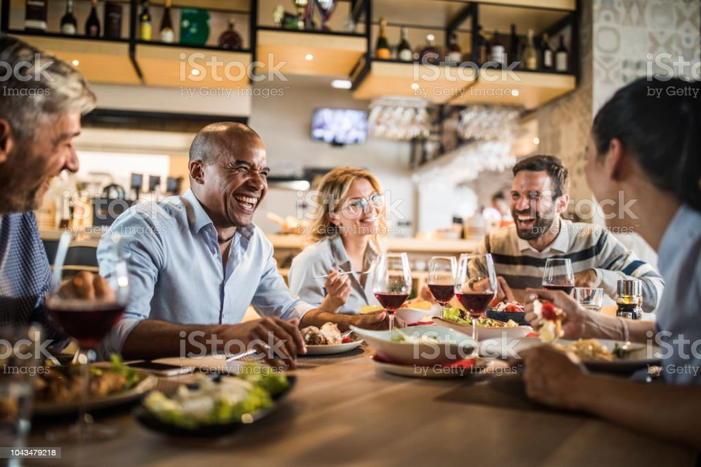 Group of cheerful business people having fun on a lunch. stock photo