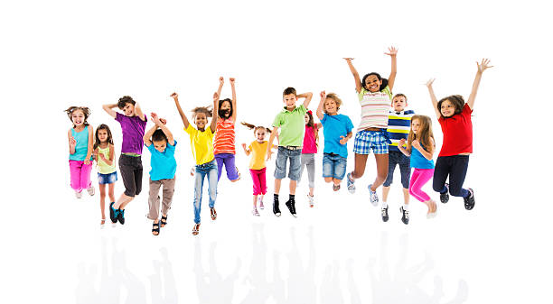 group of cheerful children jumping with arms raised. - african youth jumping for joy stock photos and pictures