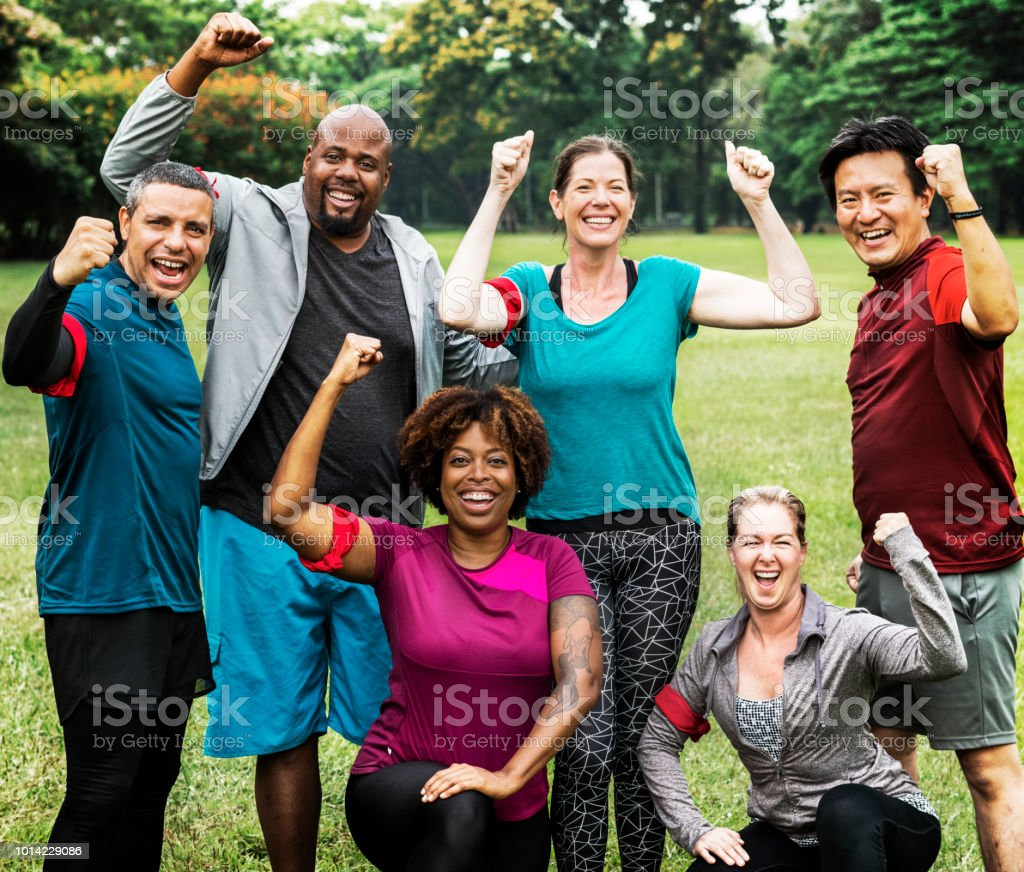 Group of cheerful diverse friends in the park stock photo