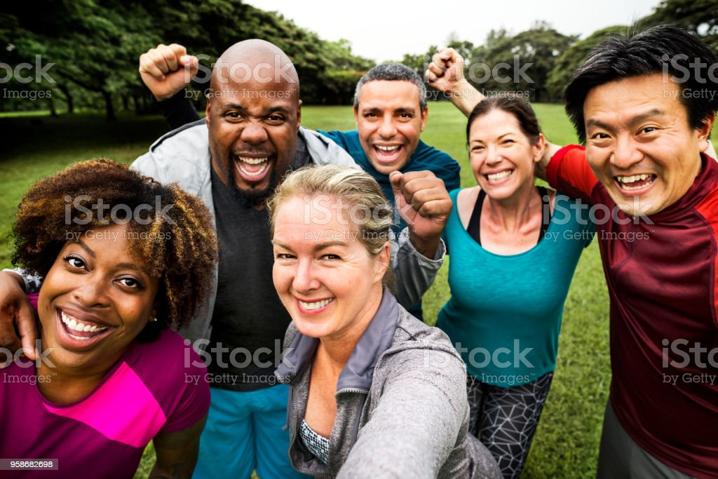 Group of cheerful diverse friends in the park royalty-free stock photo