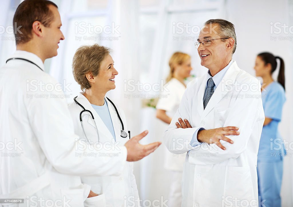 Group of cheerful doctors talking in the clinic. royalty-free stock photo