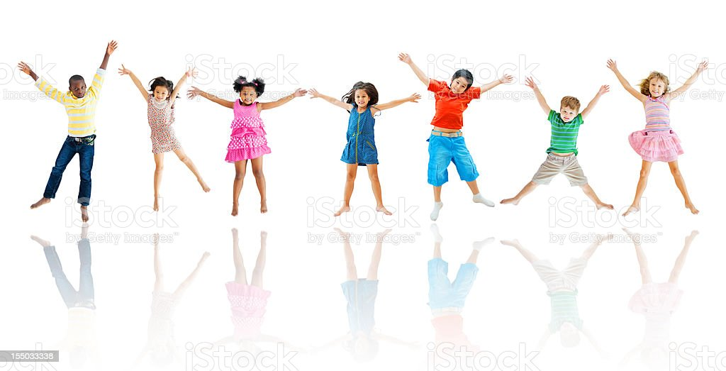 Group of cheerful kids jumping in the air royalty-free stock photo