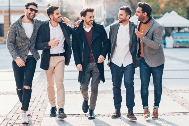 group of cheerful male friends on the street - stag night stock pictures, royalty-free photos & images