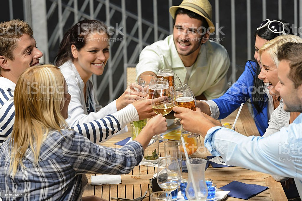 Group of cheerful people toasting with drinks royalty-free stock photo