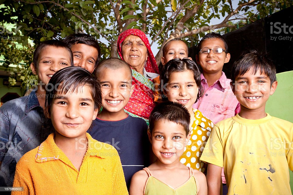 Group of Cheerful Rural Indian Children with their Grandmother Horizontal stock photo