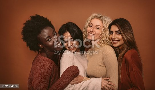 istock Group of cheerful young women standing together 872034182