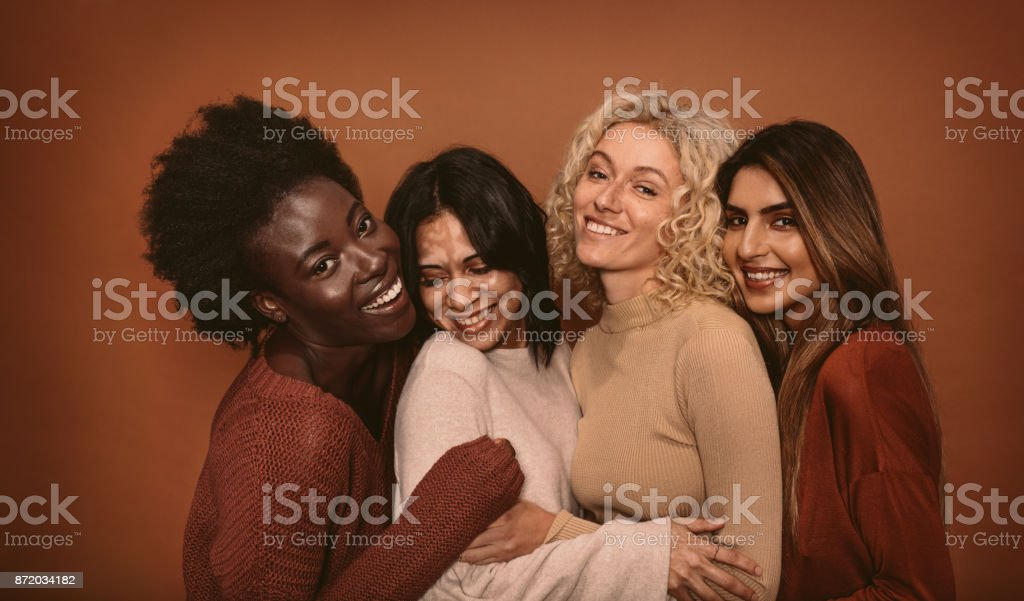 Group of cheerful young women standing together stock photo