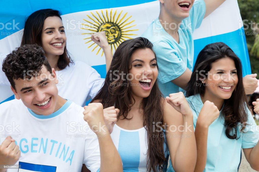 Group of cheering soccer fans from Argentina with argentinian flag stock photo
