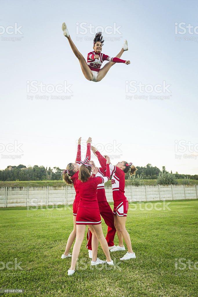 Group of Cheerleaders Performing Stunts stock photo