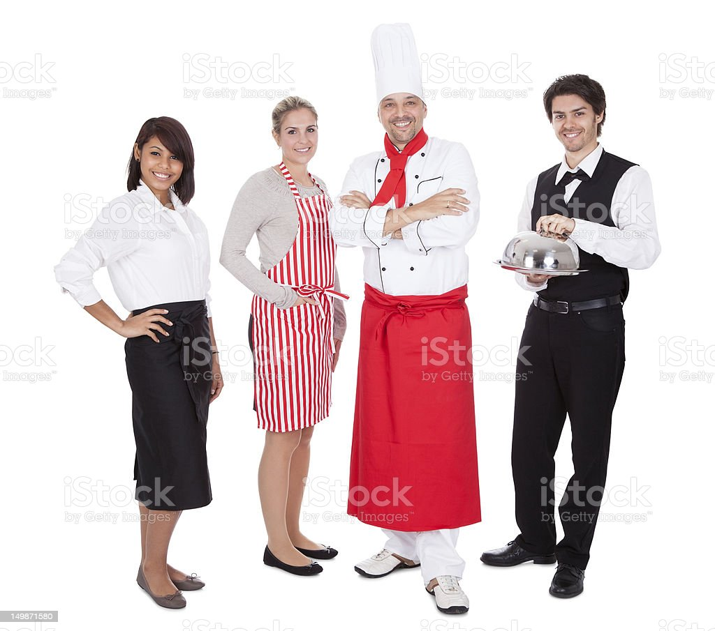 Group of chef and waiters stock photo