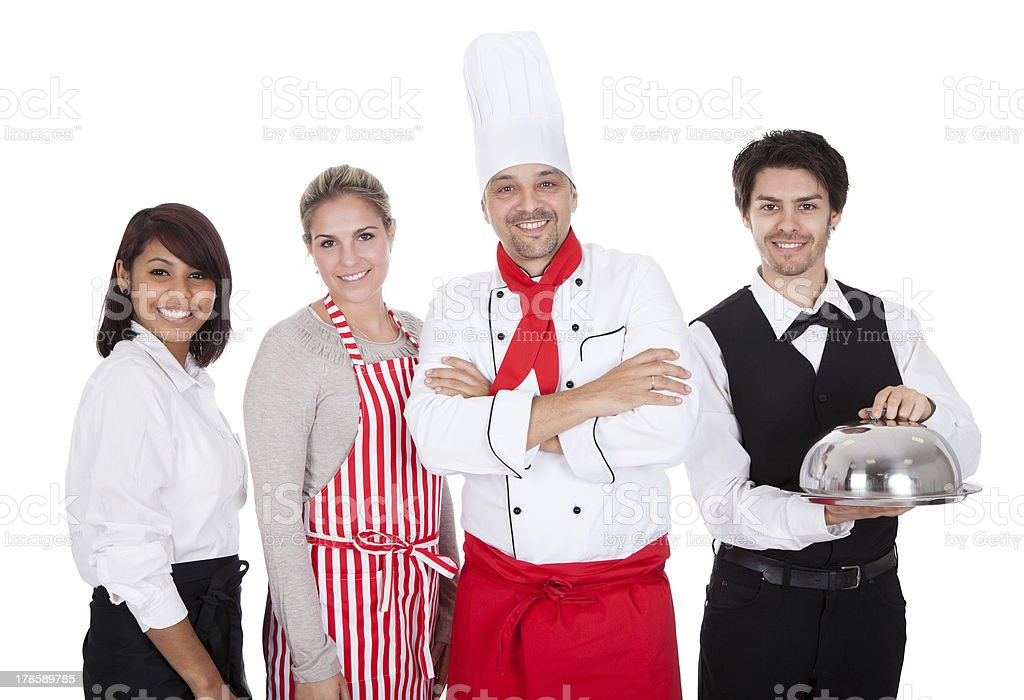 Group of chef and waiters royalty-free stock photo