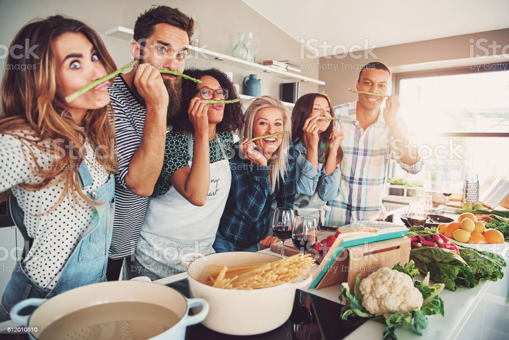 Group of chefs playing with asparagus stalks stock photo