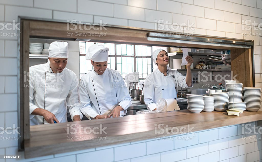 Group of chefs working at a restaurant stock photo
