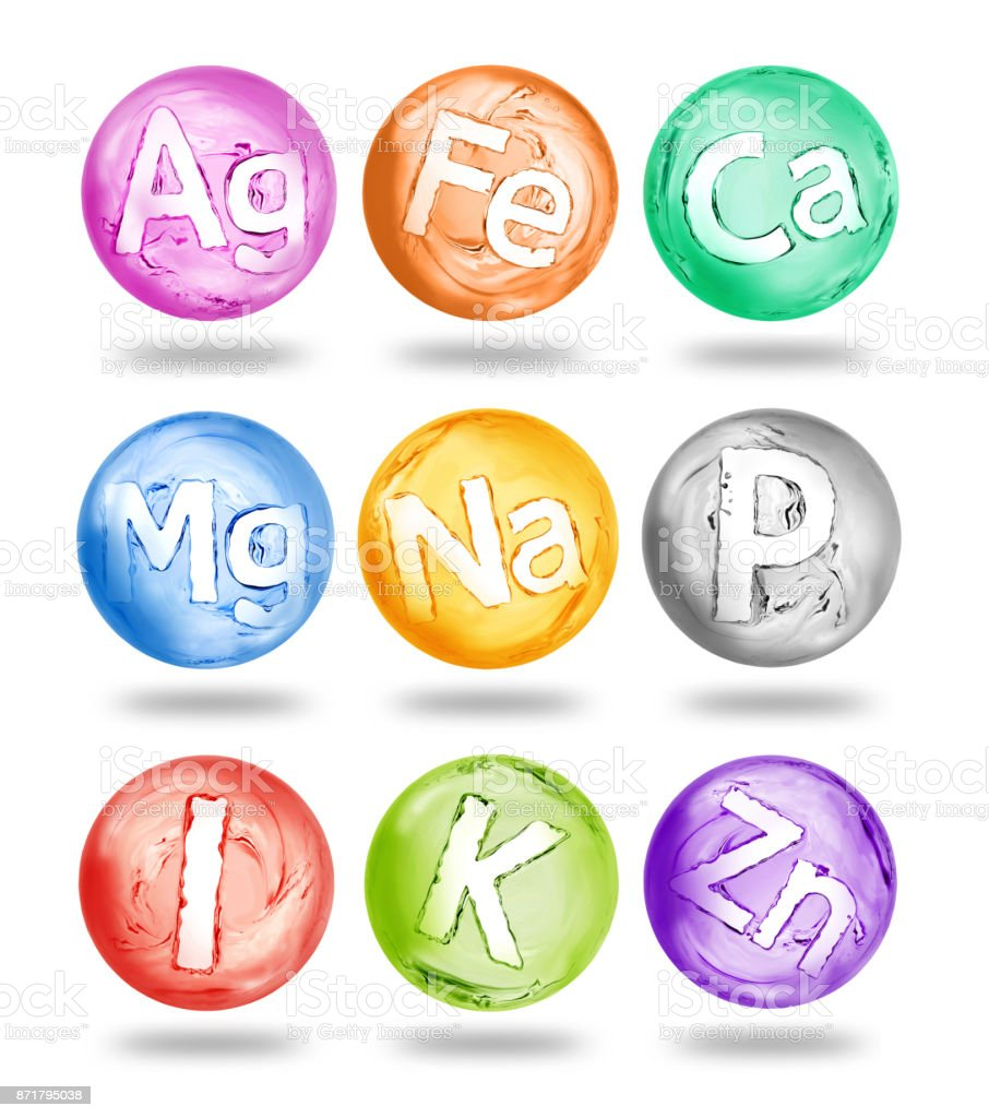 Group of chemical minerals and microelements in the form of spheres made of water stock photo