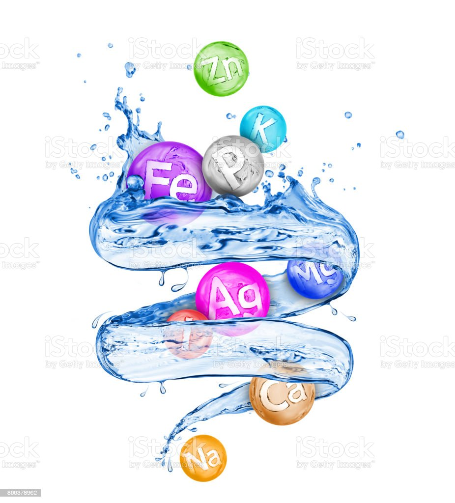 Group of chemical minerals and microelements with fresh water in a swirling shape on white background stock photo