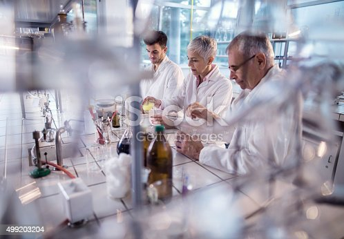 499203366istockphoto Group of chemists working on a research in laboratory. 499203204