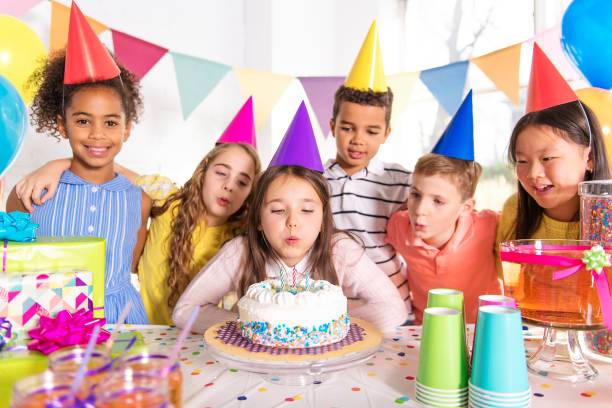 group of children at birthday party at home - birthday stock pictures, royalty-free photos & images