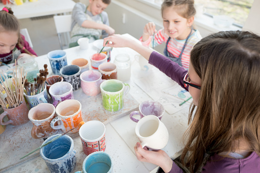 Group of children at pottery class