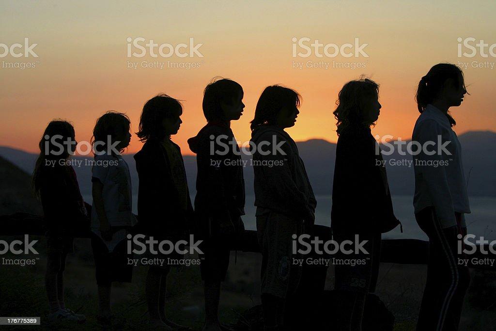group of children at sun set stock photo