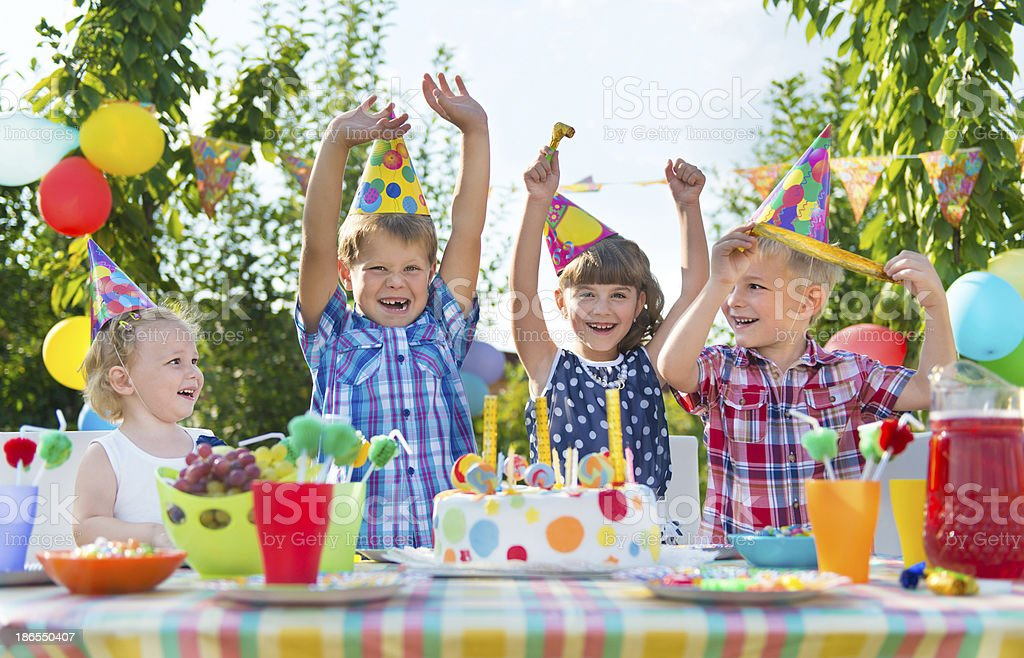 Group of children celebrating at a birthday party stock photo