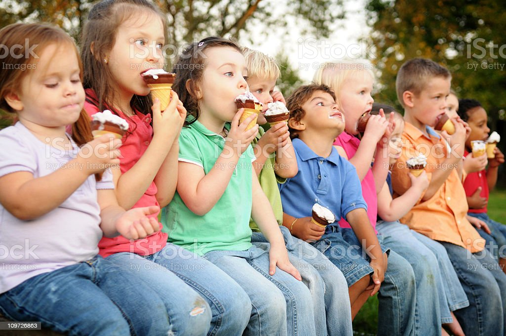 Group of Children Eating Ice Cream Cones Outside royalty-free stock photo