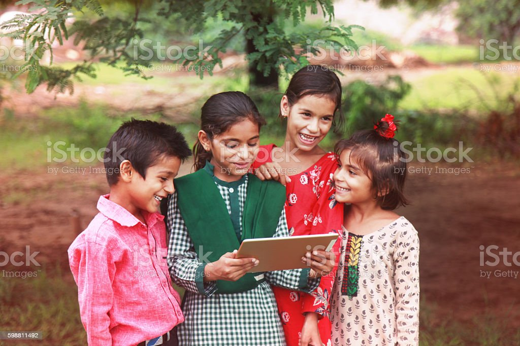 Group of children enjoying digital tablet stock photo