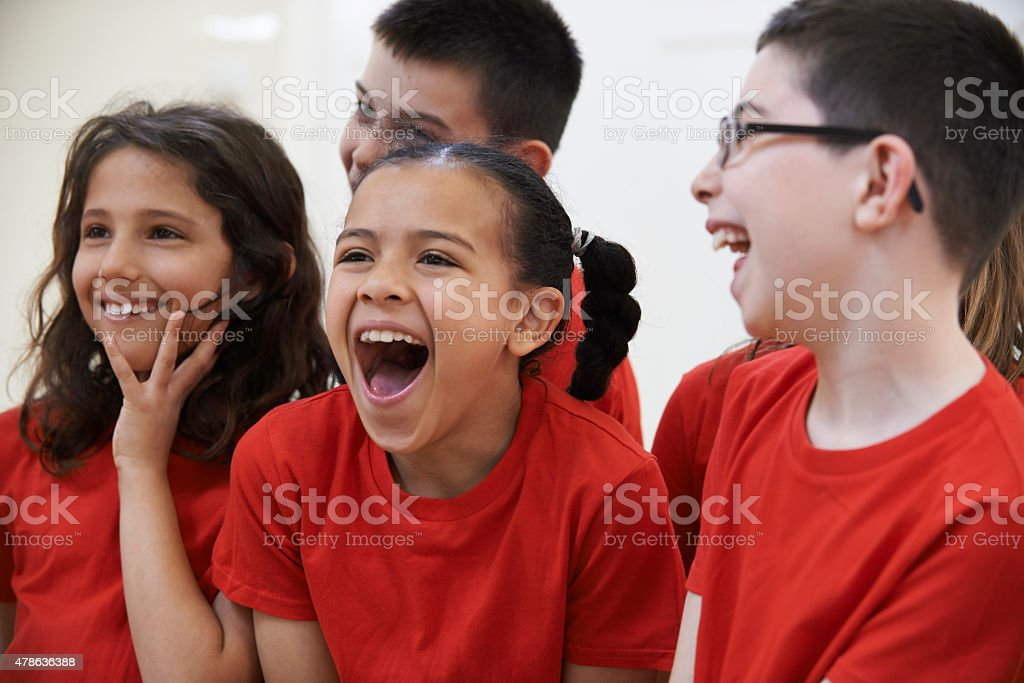 Group Of Children Enjoying Drama Class Together stock photo