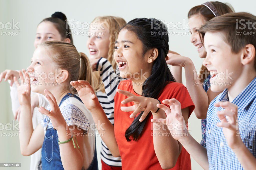 Group Of Children Enjoying Drama Club Together stock photo