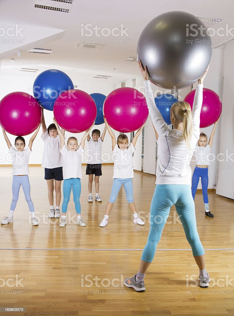 Group of children exercising with fitness balls. royalty-free stock photo