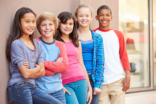 Group Of Children Hanging Out Together In Mall Group Of Children Hanging Out Together In Mall Smiling To Camera pre adolescent child stock pictures, royalty-free photos & images